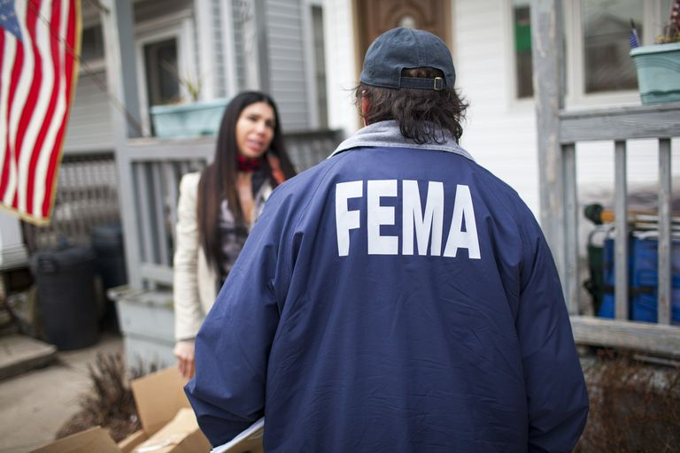 A FEMA agent helps a victim of Hurricane Sandy