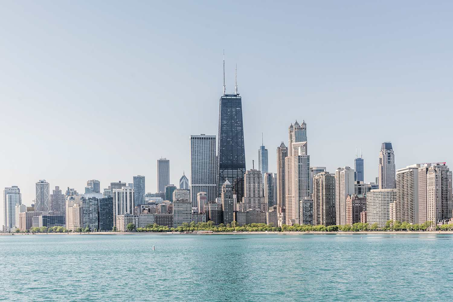 Chicago skyline with lake Michigan against clear sky,Illinois
