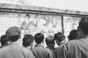Beijing residents read posters chastising