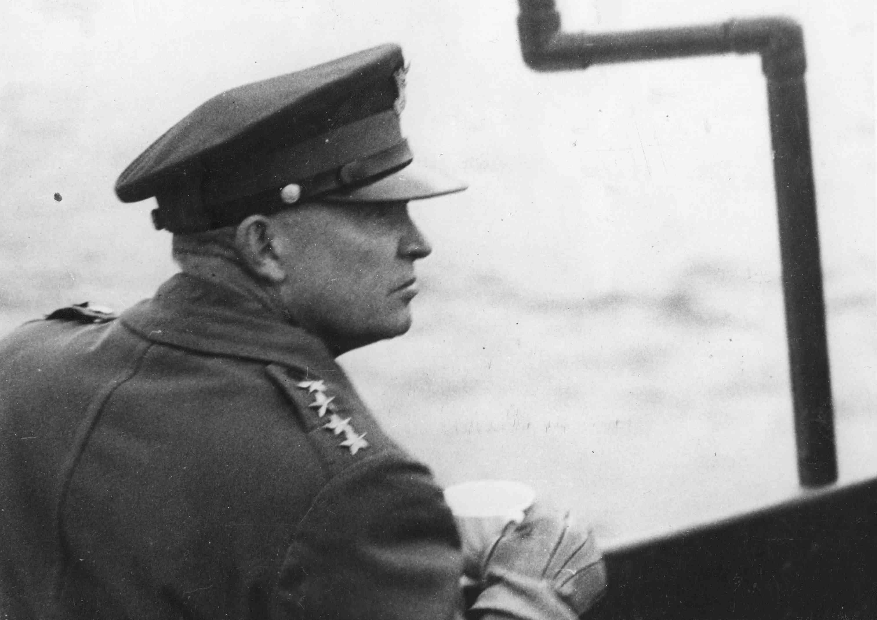 General Dwight D Eisenhower (1890 - 1969), Supreme Commander of the Allied Forces, watches the Allied landing operations from the deck of a warship in the English Channel during World War II, June 1944. Eisenhower was later elected the 34th President of the United States