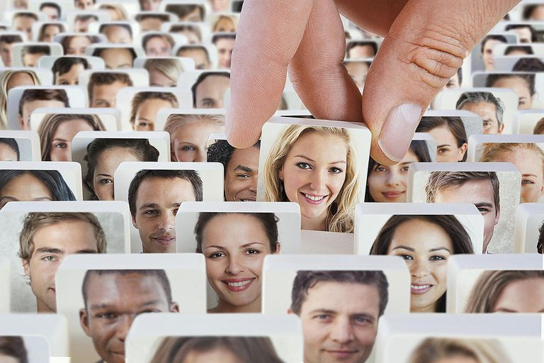 Individual faces on disks symbolize who individuals can be units of analysis within sociological research.