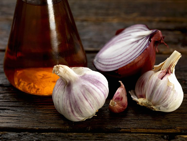 garlic next to jar of vinegar