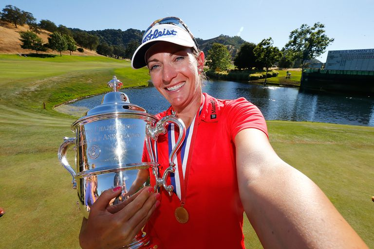 Brittany Lang holds the US Women's Open trophy after winning in 2016