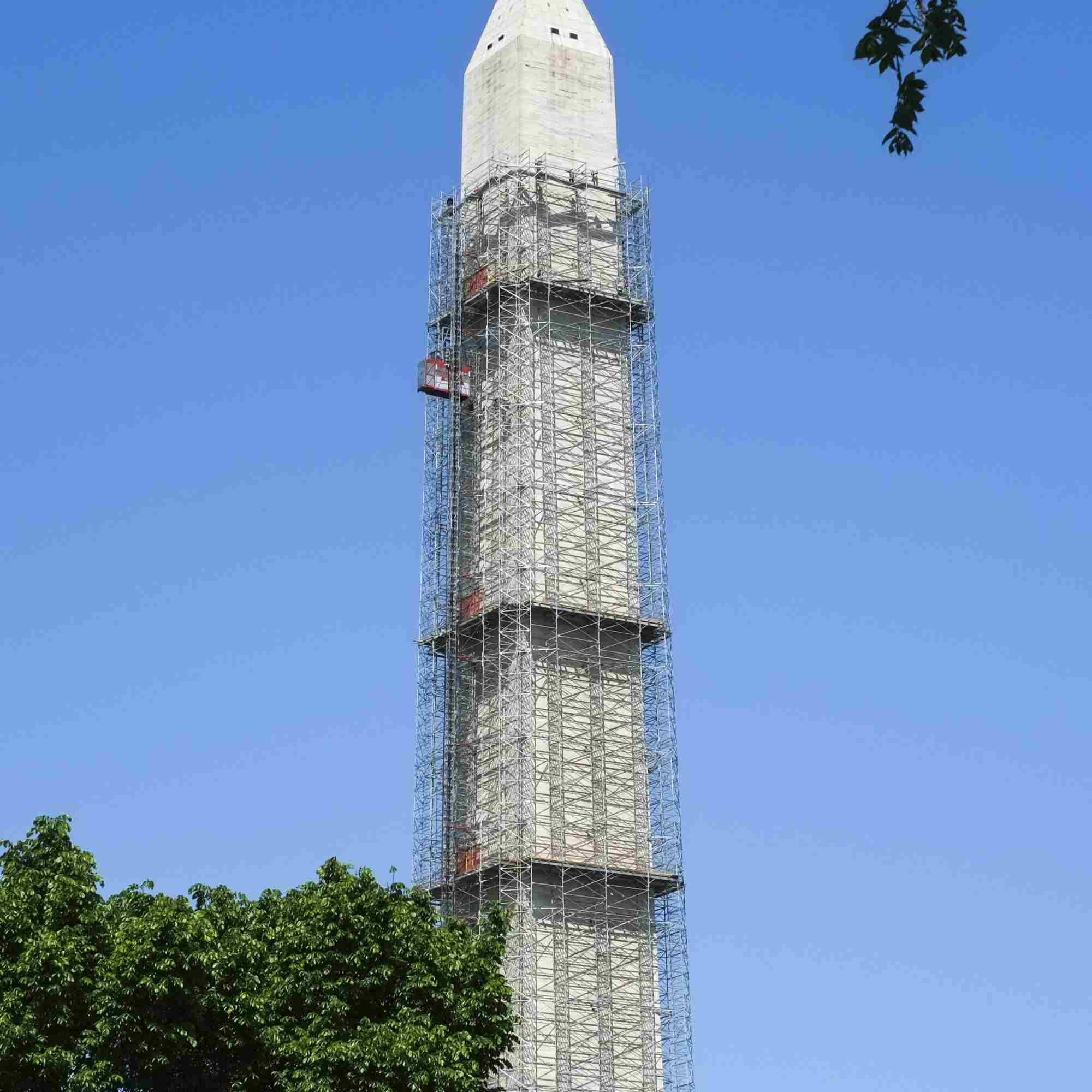 The Washington Monument is covered in scaffolding to repair earthquake damage