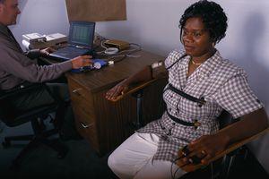 woman taking a lie detector test