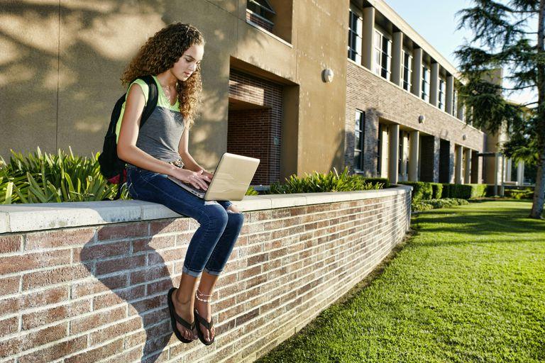 high school student using laptop