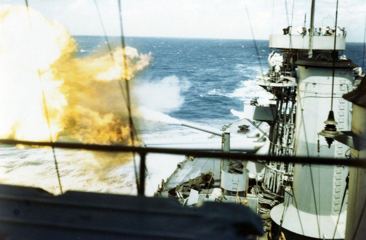 Looking aft on battleship USS Colorado with 16 inch guns firing.