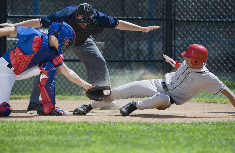 Baseball Player Sliding Into Home Plate