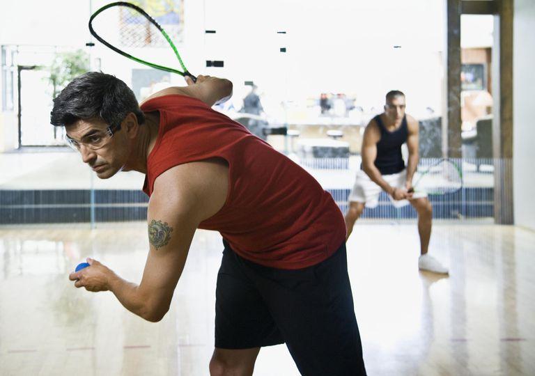 Two men playing squash