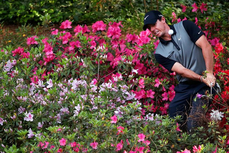 Rory McIlroy hits out of the azalea bushes at Augusta National