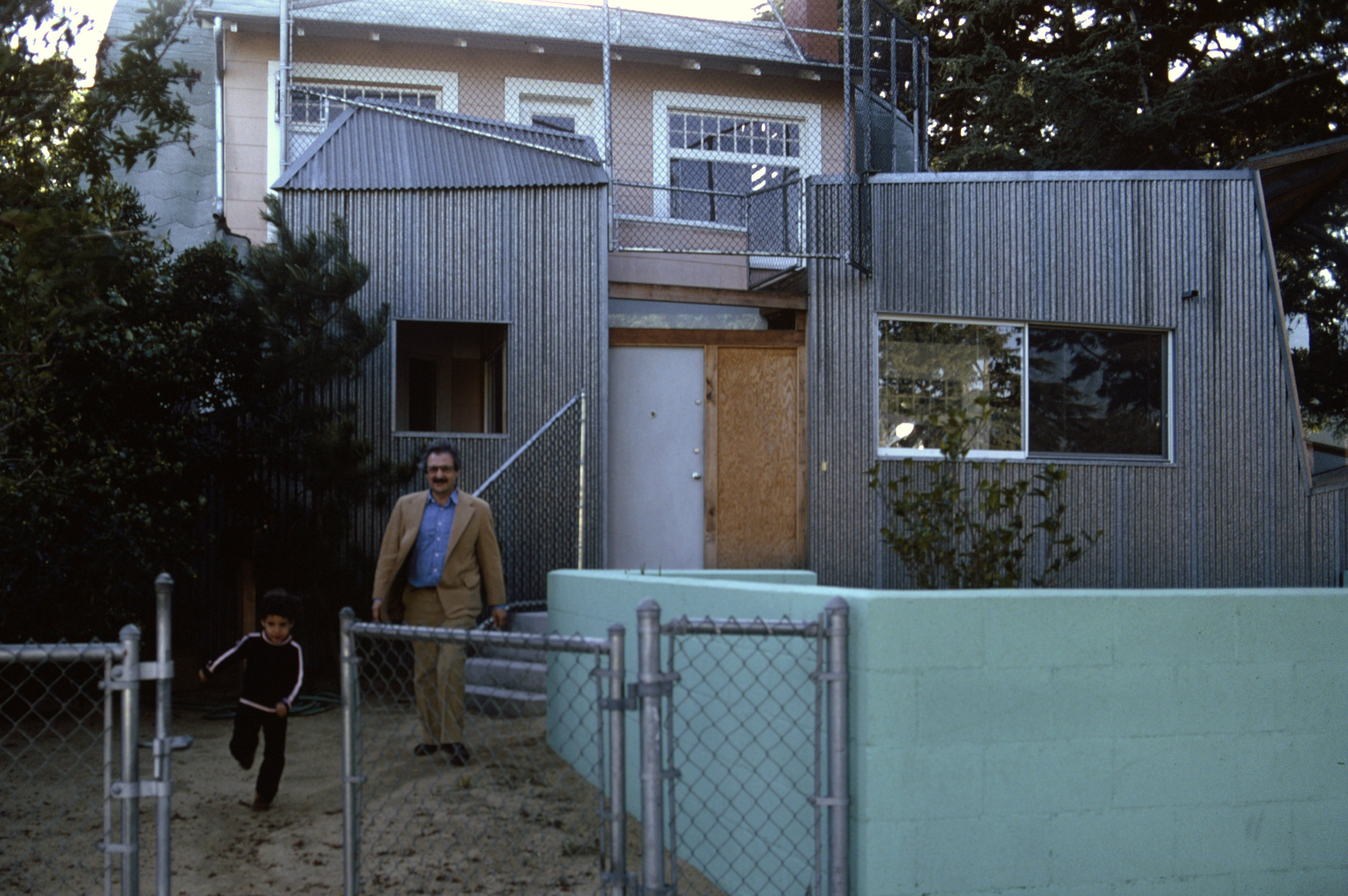 Frank Gehry and His Son, Alejandro, in Front of the Gehry Residence in Santa Monica, c. 1980