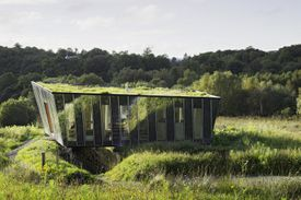Glass house with green roof blends into the Irish countryside, the Mimetic House by Irish Architect Dominic Stevens, Dromahair, County Leitrim, Ireland, 2006