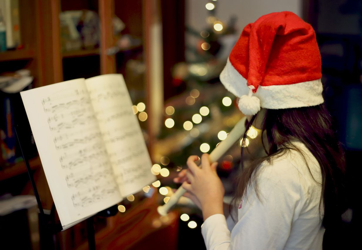 a girl playing christmas music - Free Christmas Piano Sheet Music