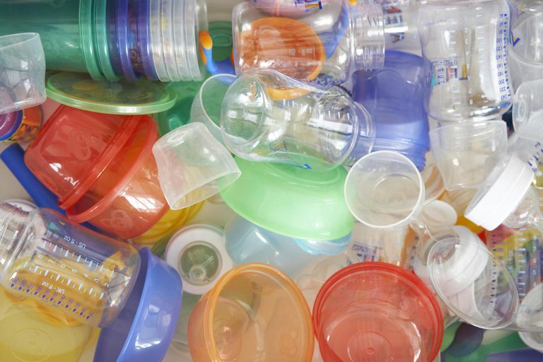Plastic baby bottles and dishes, close-up