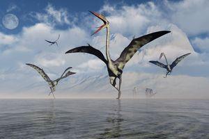 Illustration of Quetzalcoatlus pterosaurs gathering at water
