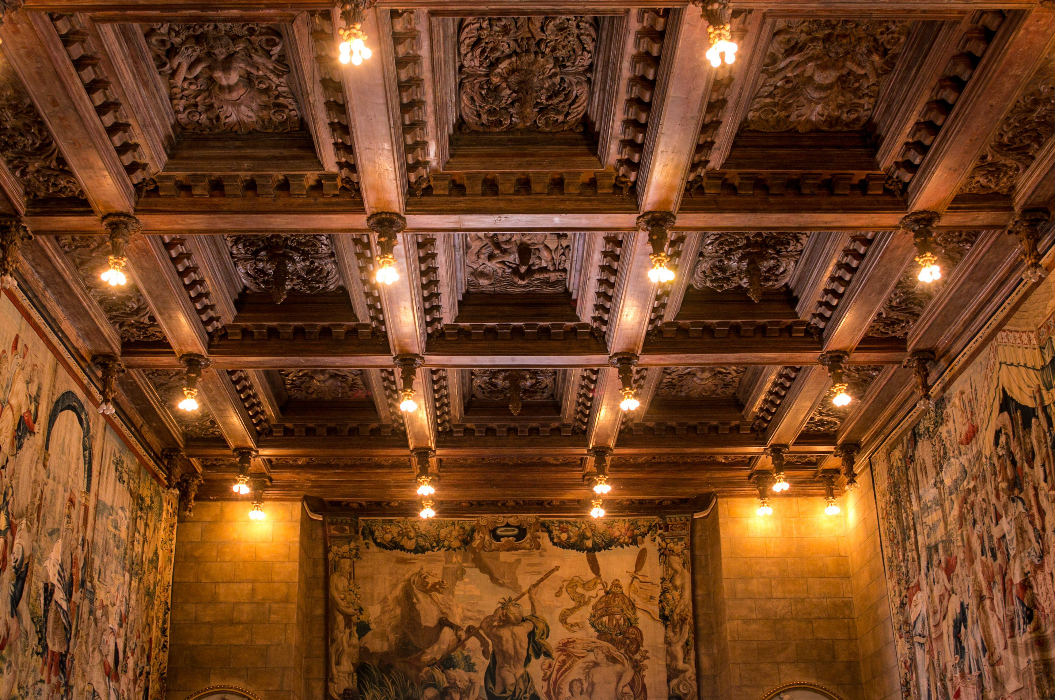 The ornate ceiling of the Assembly Room is viewed on a Great Room Tour at Hearst Castle