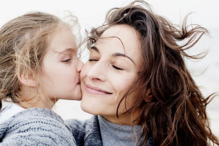 mother and child kissing outdoors