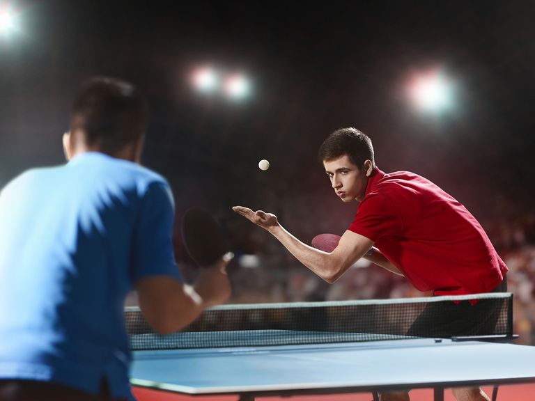 Two Ping Pong Players Play Table Tennis