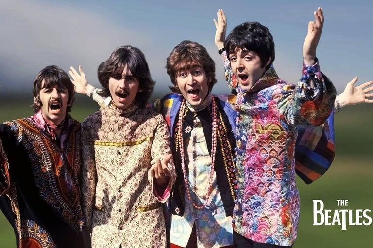 The four members of the British rock group the Beatles performing