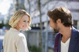 man and woman smiling flirtatiously