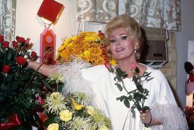 Zsa Zsa Gabor arranging roses in a publicity image.