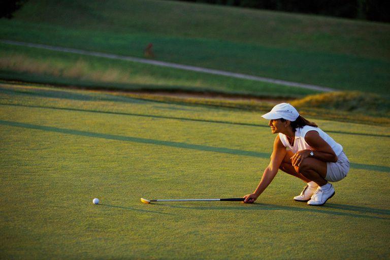 Woman lining up a putt