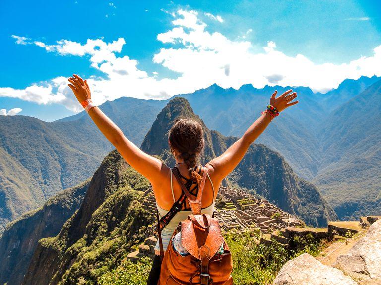 woman looking at Machu Picchu