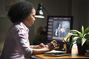 Mixed race businesswoman taking online class on computer