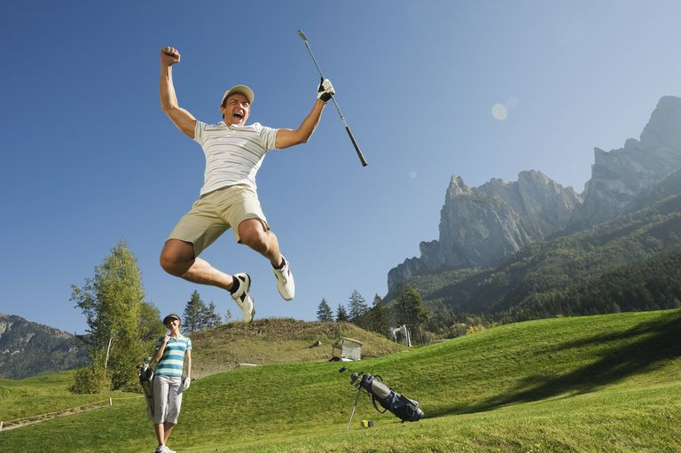 Golfer leaps into the air in celebration