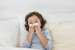 A child sick in a bed