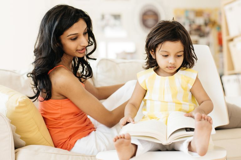 Woman reading with a young child