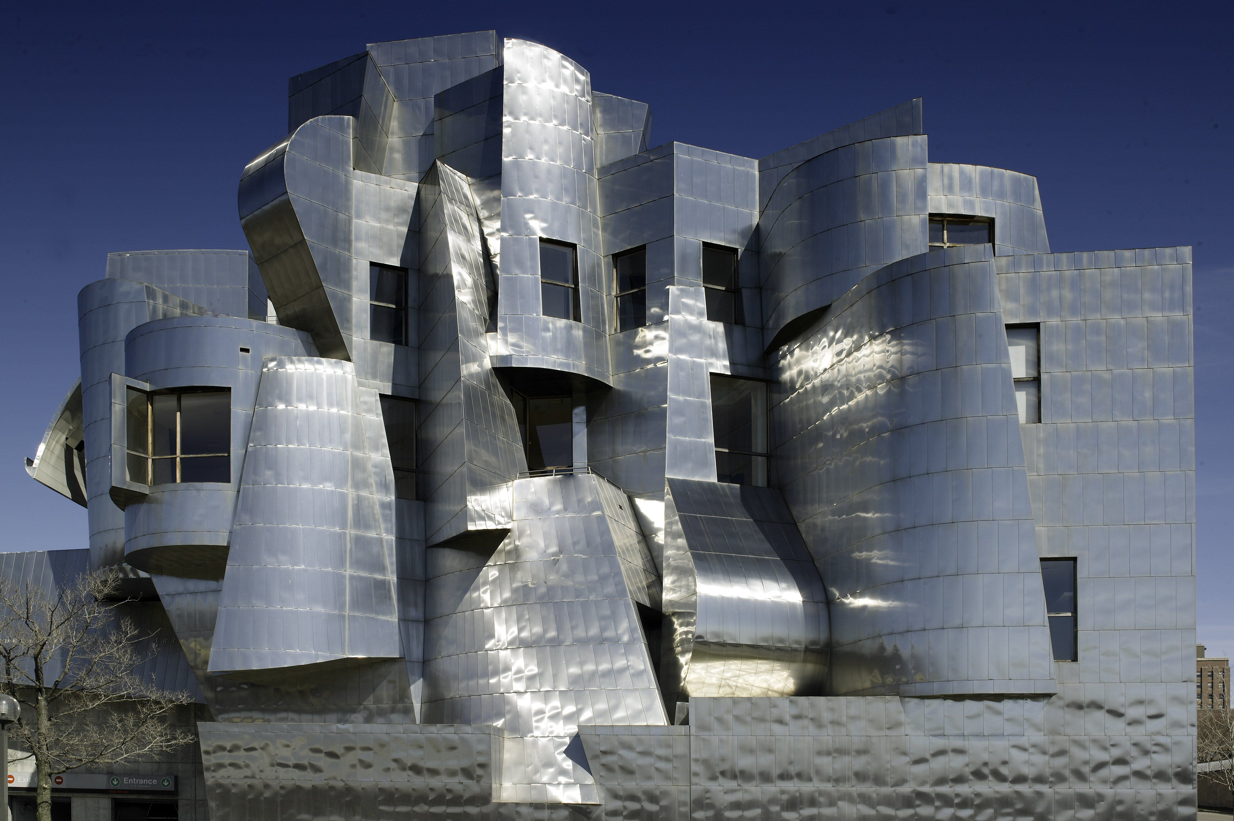Stainless steel wavy skin facade with windows irregularly cut out