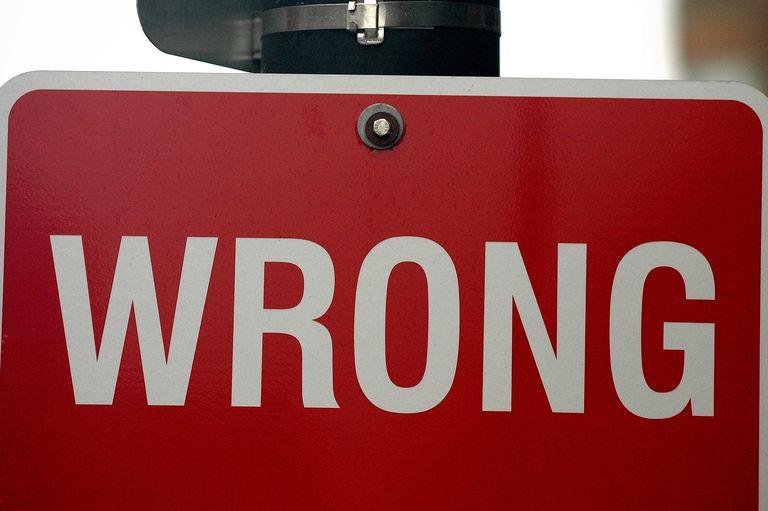 "street sign saying ""wrong"""