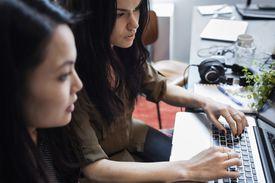 Women working at a laptop computer