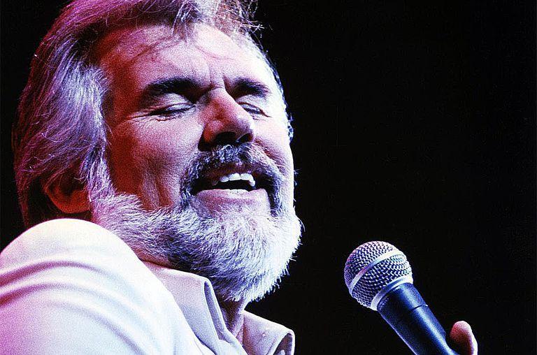 American singer-songwriter Kenny Rogers performing, circa 1980.