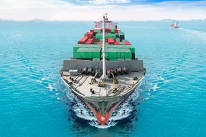 aerial view container ship or cargo vessel sailing ship at sea at blue sky