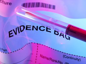 An evidence bag containing a blood sample