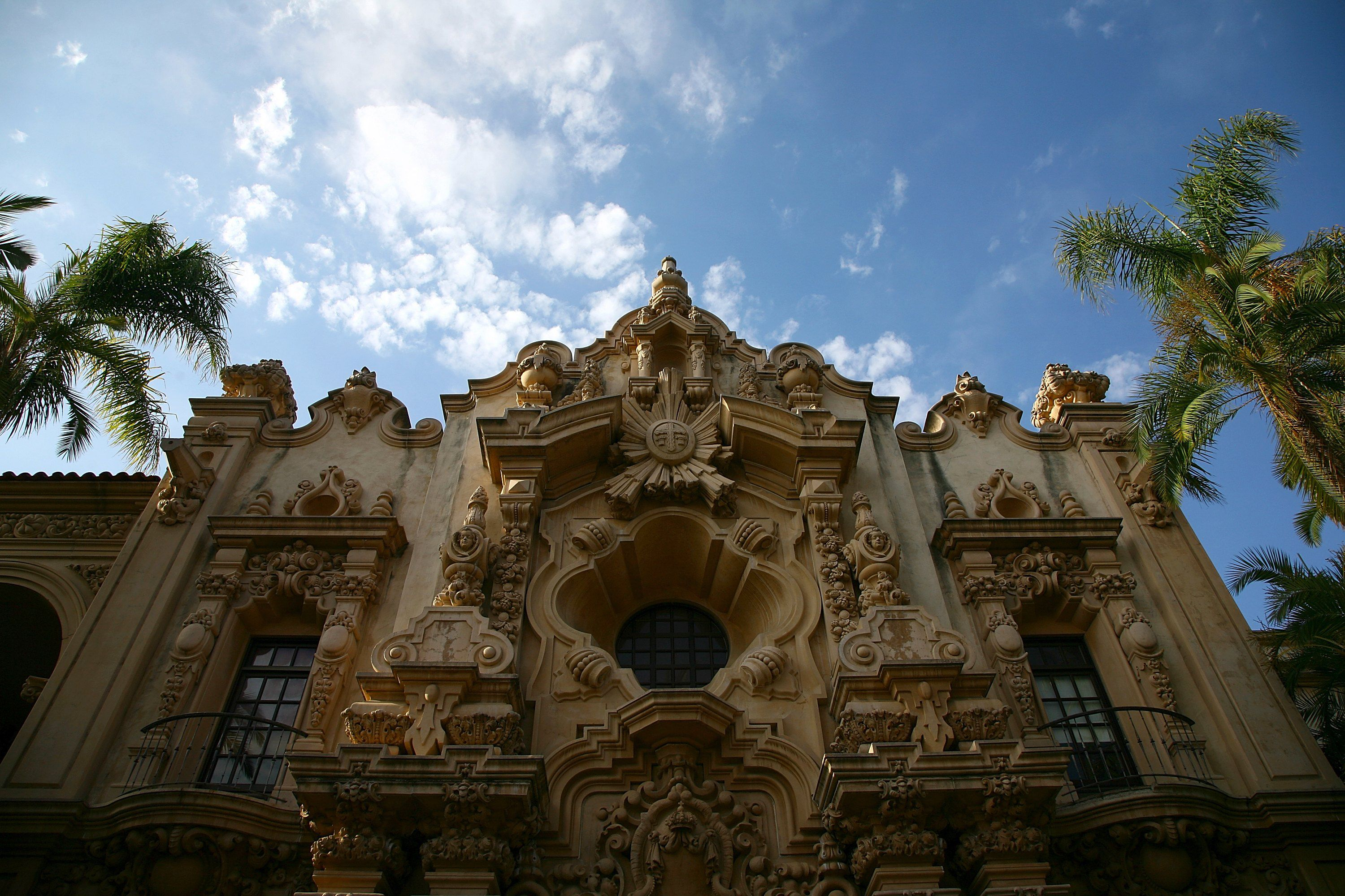 detailed facade of ornate building in San Diego, California, palm trees