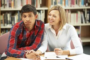 A student with a teacher in the library