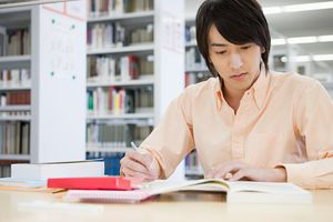 Young man studying in library