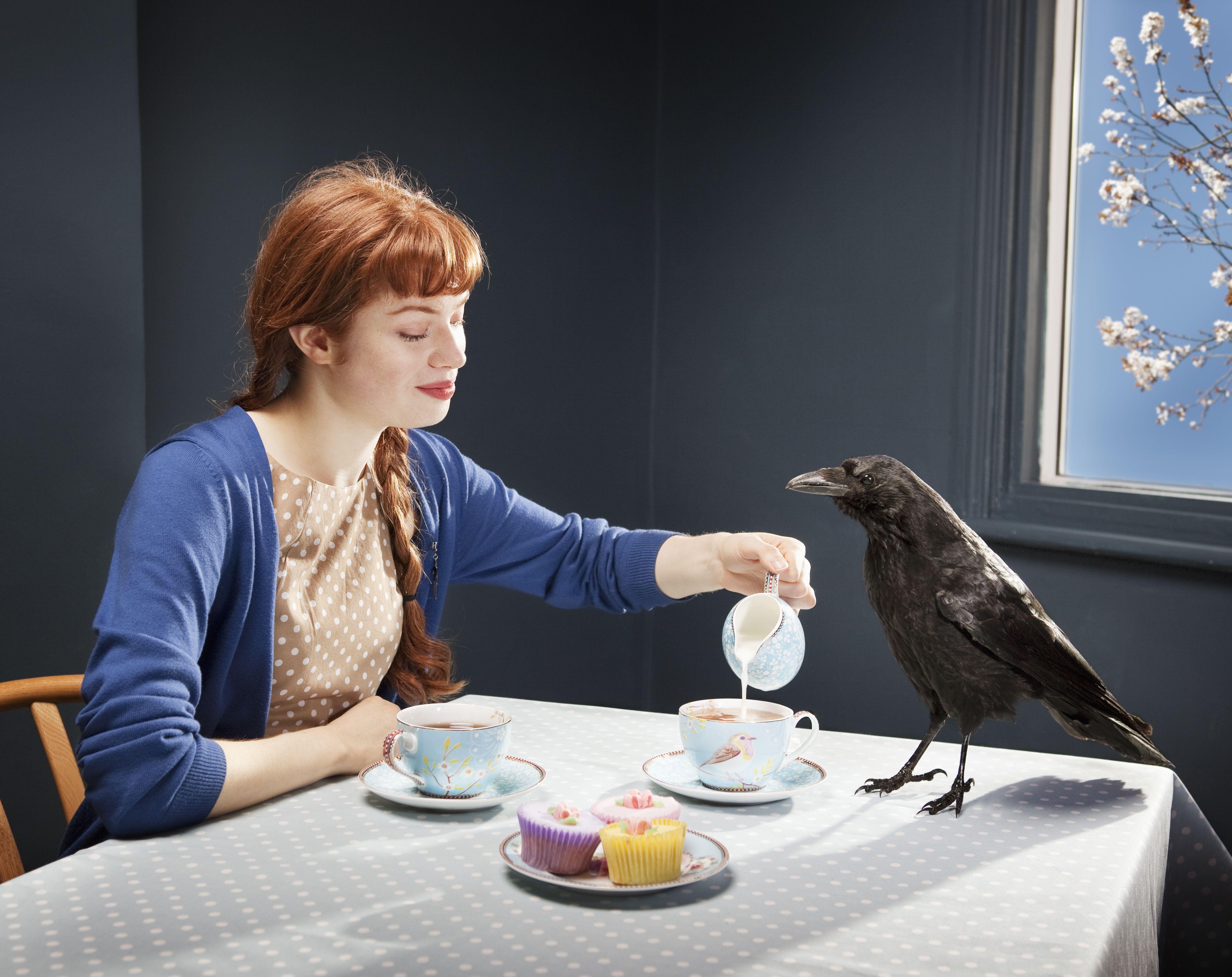 woman serving crow tea