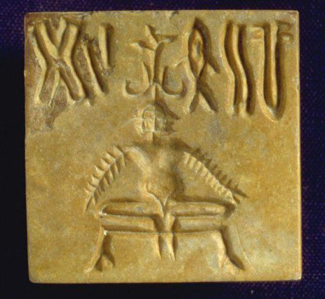 Indus Script fiwith figure underneath on square tablet