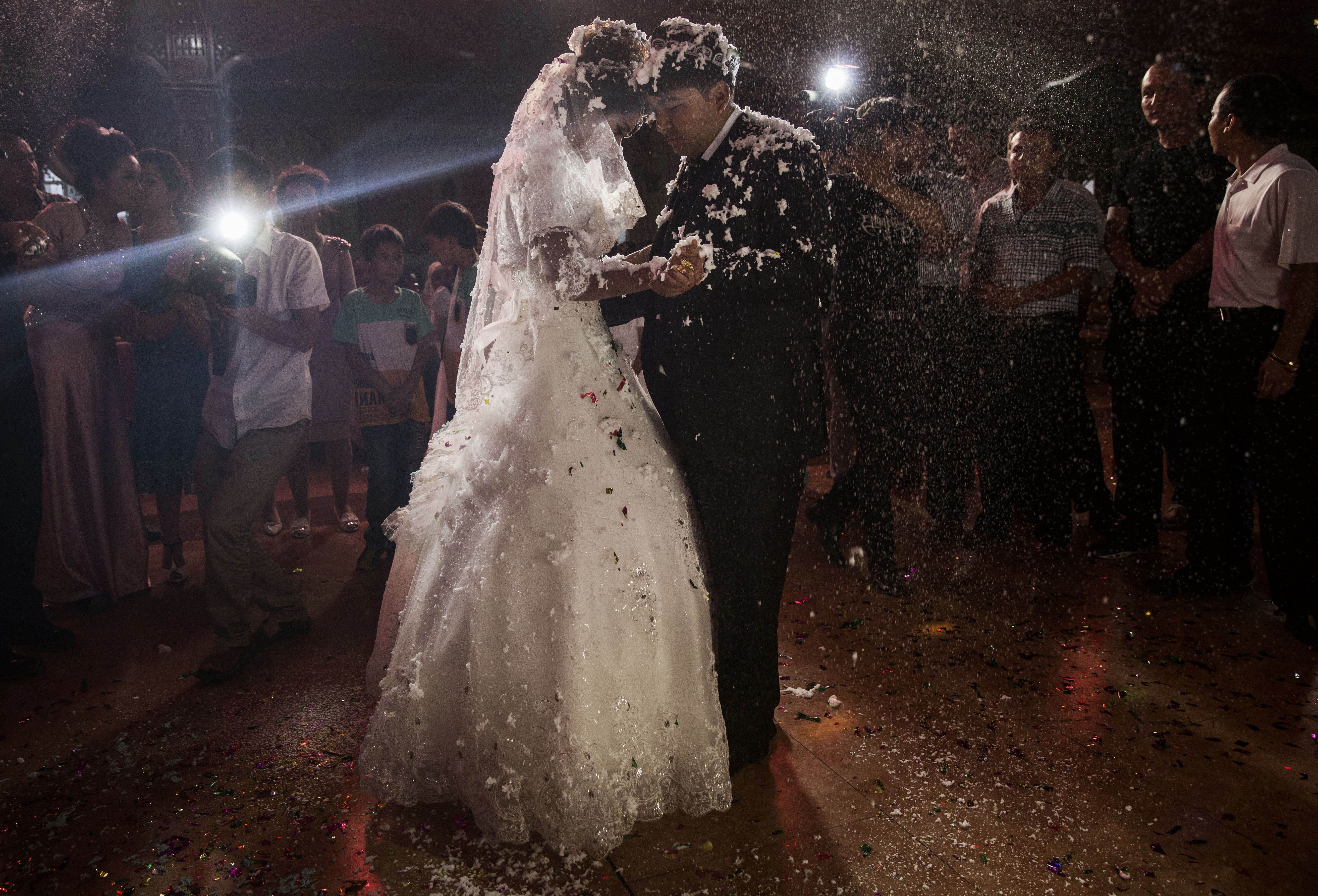 A Uyghur Couple Dance At Their Wedding In Kashgar China Kevin Frayer Getty Images