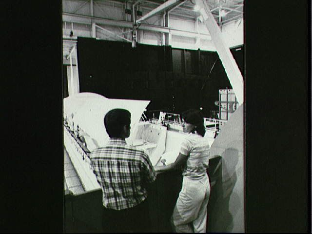 Astronauts Sally Ride and Terry Hart prepare for RMS training for STS-2, 1981.
