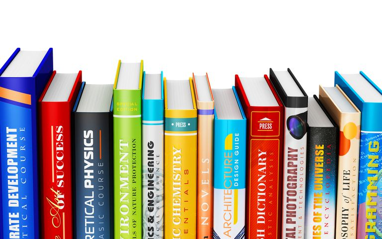 row of textbooks on white background