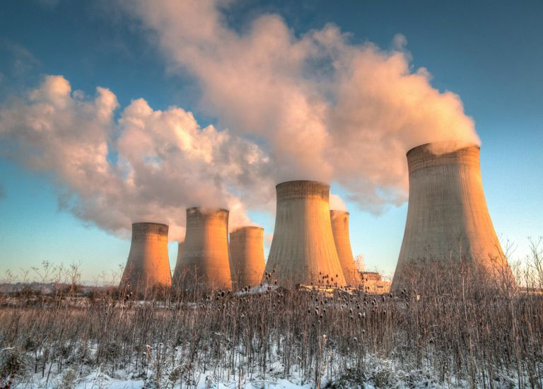 Power plant cooling towers at sunrise.