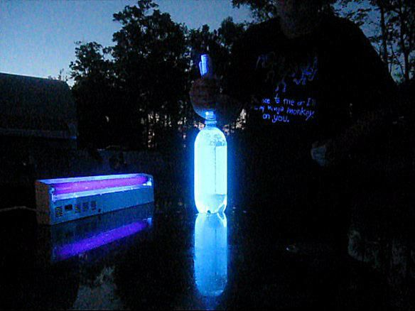 setting up a glowing Mentos and tonic water fountain.