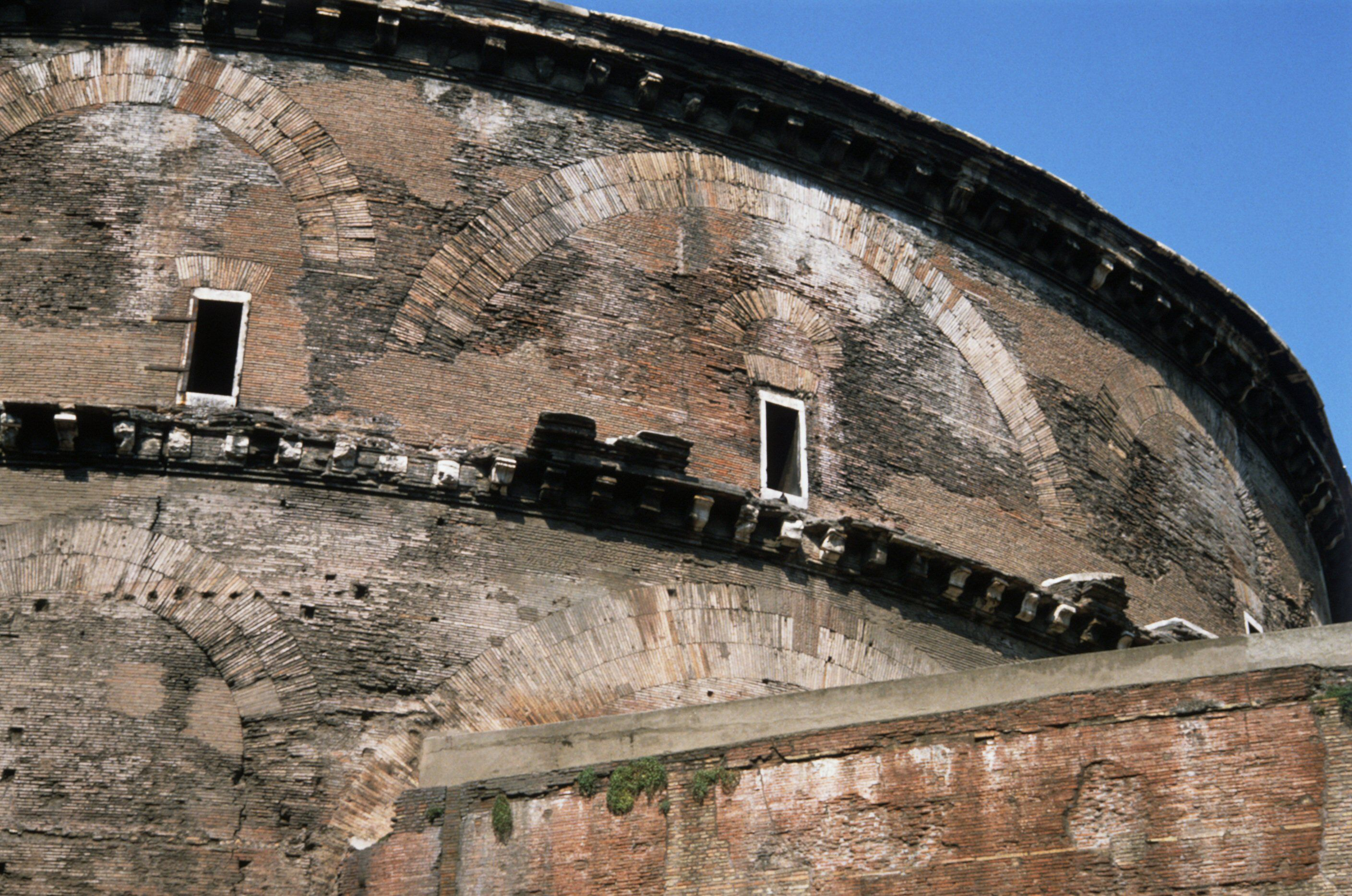 noticeable brick-looking arches built into the curving exterior wall of the dome room