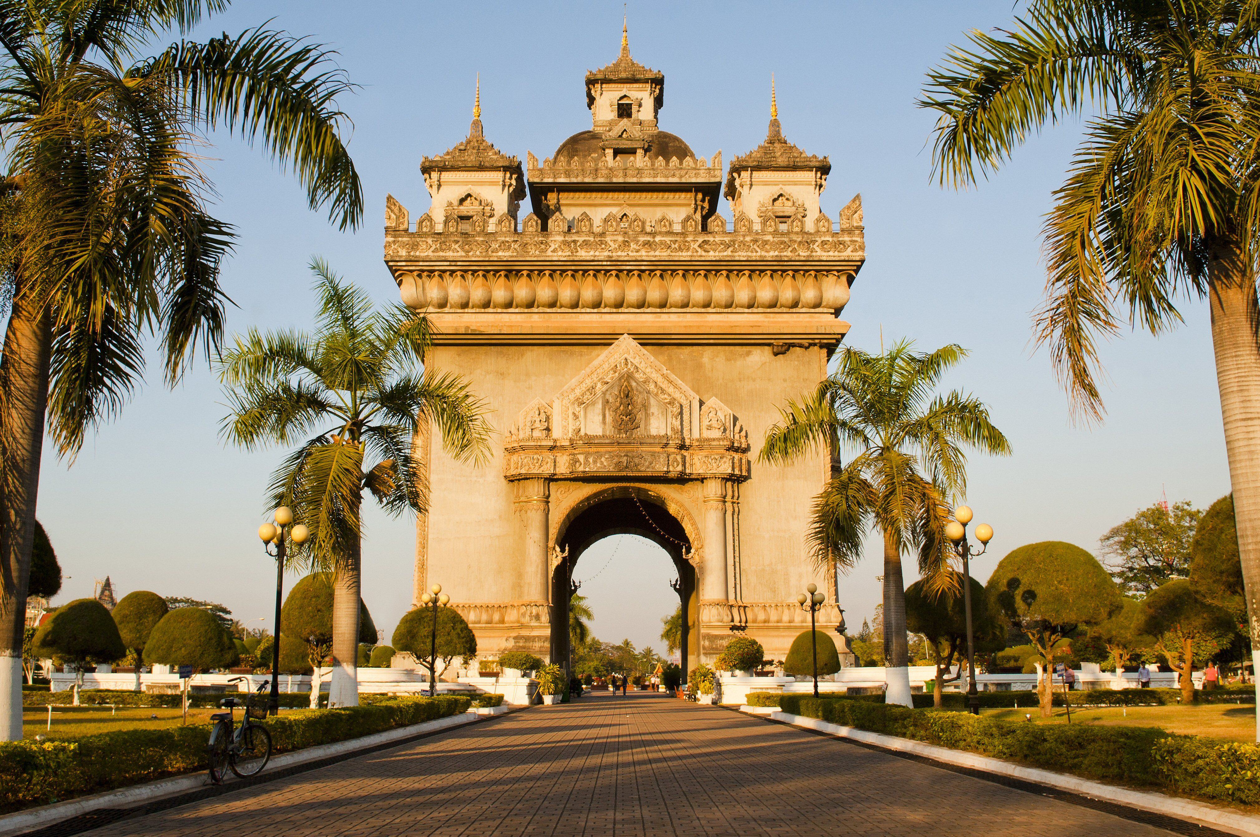 large archways similar to Arc de Triomphe in Paris but with Asian detailing