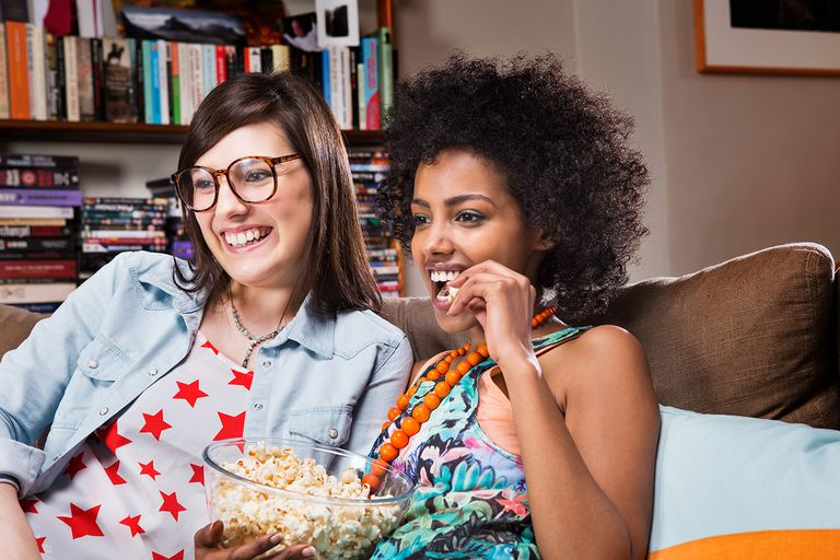 Women watching television in livingroom.